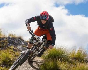 Queenstown mountain bike rider Jimmy Pollard on his way to winning the first of two rounds of the...