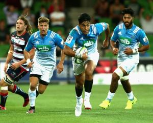 Rieko Ioane makes a break for the Blues against the Rebels in Melbourne last night. Photo: Getty...