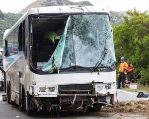 The recovered bus that crashed into steep bush near Akaroa. Photo: Martin Hunter