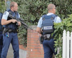 Armed police on Woodley Ave in Remuera after reports of gunshots in the area. Photo: NZ Herald