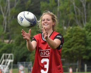 Rower Hannah Duggan receives the ball at the Going for Gold session at Logan Park on Saturday....