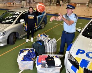 Greg Brockbank, of Basketball Otago, and policeman Tim Coudret at the Edgar Centre yesterday with...