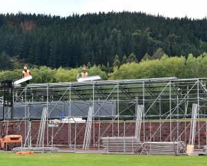 Scaffold goes up at the University Oval yesterday in preparation for the first test against South...