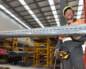 Storeman-distribution Phil Mattocks stocks shelves in Steel & Tube's new building. Photo:...