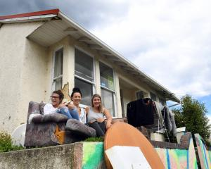 Visitor Kopare Williams (18 ,left) relaxes with two residents of a Hyde St flat, Aroha Raukaura ...