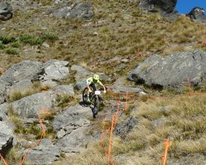 Elite women's entrant Kim Hurst, of Wellington, on a practice run down rocky outcrop, one of the...