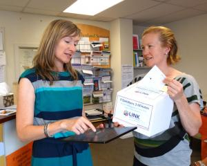 Kathy Dedo (left)  and Sophie Ward of Link Upper Clutha fill in the 3 Questions survey online and...