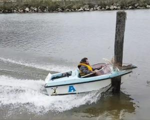 Greymouth jetboater Kieran Wisdom as his boat crashes on the Grey River on the West Coast two weeks ago. Photo: Supplied