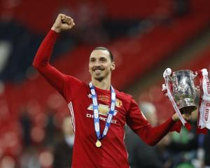 Zlatan Ibrahimovic celebrates after winning the League Cup. Photo: Reuters