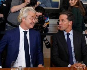 Dutch Prime Minister Mark Rutte (right), of the VVD liberal party, talks with Dutch far-right...