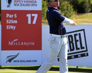 Tournament leader Brad Kennedy, of Australia, tees off on the 17th hole at Millbrook during the...