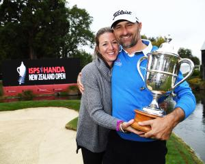 New Zealander Michael Hendry and his wife, Tara, hold the Brodie Breeze Trophy he received for...