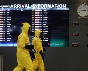 A Hazmat team checks at KLIA2 airport terminal. Photo: Reuters