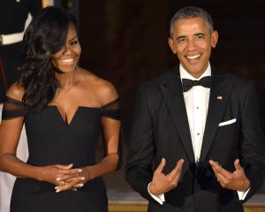 Barak and Michelle Obama are to publish a book each. Photo: Reuters