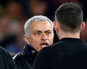 Manchester United manager Jose Mourinho remonstrates with referee Michael Oliver after the match....