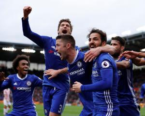 Chelsea players celebrate their second goal. Photo Reuters