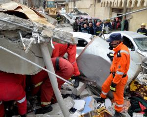 Rescue workers search for bodies after the air strike. Photo Reuters