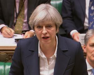 Britain's Prime Minister Theresa May speaks in Parliament as she announces that she has sent the...