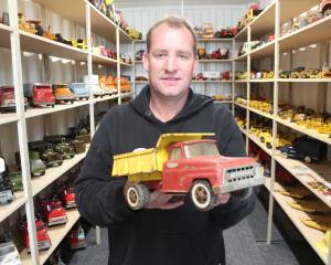 Wayne Spence with the Tonka truck that inspired him to collect hundreds of the vintage toys and...