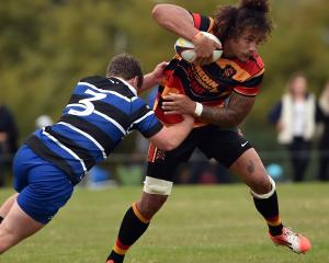 Zingari flanker Eli Tonga tries to get away from Kaikorai prop George Hendry at Montecillo on...