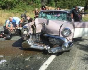 The Clarkes' Buick after it collided with a motorcycle on their way to the Whangamata Beach Hop....