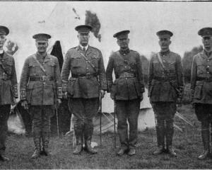 Officers of the Coast Defence detachment in camp at Waitati. From left: Captain-chaplain Saunders...