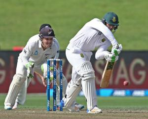 Quinton de Kock batting for South Africa as BJ Watling watches on for New Zealand. Photo: Getty...