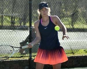 Women's singles winner Emilia Price plays a forehand during the Otago Open at Logan Park over the...