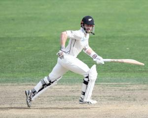 New Zealand's Kane Williamson runs between the wickets during his innings yesterday against South...