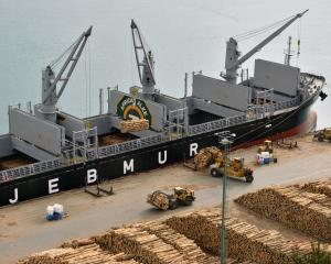 Logs are loaded into the African Alke at the Beach St wharf in Port Chalmers last year. Photo:...
