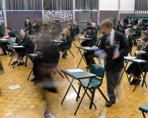 Pupils at Dunedin's Kaikorai Valley College stream into the school hall for an NCEA exam. Photo...
