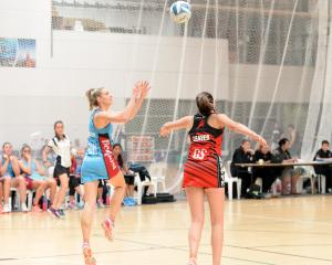 Southern Steel goal keep Jane Watson (left) is about to intercept a pass meant for Mainland...