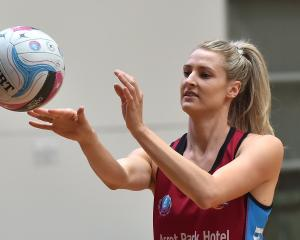 Steel and Silver Ferns defender Jane Watson passes the ball during training at the Edgar Centre...