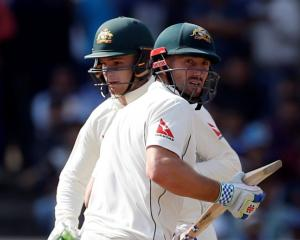 Peter Handscomb and Shaun Marsh run between the wickets for Australia. Photo: Reuters