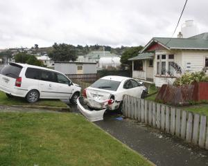 The abandoned vehicle (right) that smashed into Oamaru man Naruedom Yaempongsa's car. Photo by...