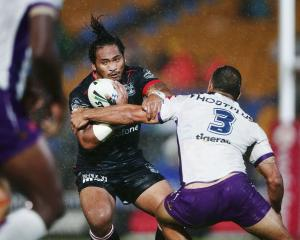 Solomone Kata runs the ball for the Warriors against the Melbourne Storm. Photo: Getty Images