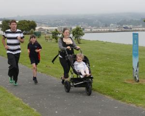 Training on Portsmouth Dr before of this weekend's Stadium to Surf Fun Run are (from left) Graham...