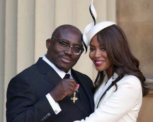Edward Enniful with model Naomi Campbell after receiving his OBE last year. Photo: Reuters