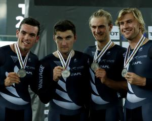 The New Zealand team celebrate with their silver medals. Photo Reuters
