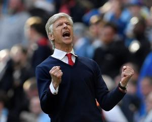 Arsenal manager Arsene Wenger celebrates his side's victory. Photo Reuters / Toby Melville Livepic