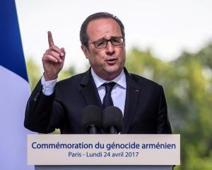 French President Francois Hollande speaks during a ceremony in memory of mass killings of...