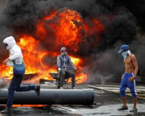 Demonstrators build a fire barricade during a rally against Venezuela's President Nicolas Maduro...
