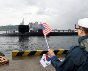 USS Michigan arrives for a port visit in Busan, South Korea. Photo Reuters