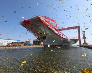 China's first domestically built aircraft carrier during its launching ceremony in Dalian, China....