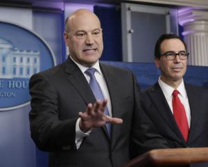 U.S. National Economic Director Gary Cohn (L) and Treasury Secretary Steven Mnuchin