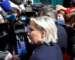 Marine Le Pen arrives at her campaign headquarters in Paris. Photo Reuters
