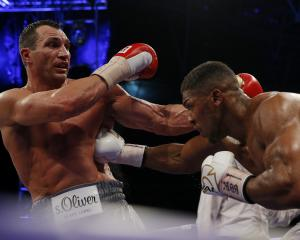 Anthony Joshua (R) lands a punch on Wladimir Klitschko. Photo Getty