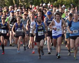 Competitors roar out of the blocks at the start of the Three Peaks mountain race in Dunedin...