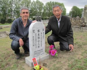 A plaque marks the restored headstone of Chinese elder Cheung Ling Kong at the Alexandra cemetery...