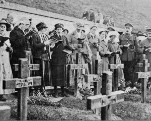 On All Saints' Day this impressive service was held in a little churchyard ``somewhere in France'...